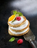 A pancake tower with fruit and mint