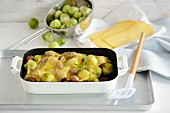 Brussels sprouts and chestnuts topped with melted cheese