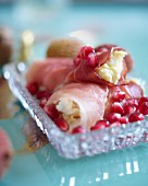 Ham rolls with egg cream and pomegranate seeds for breakfast