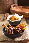 Spiced Moroccan lamb shanks with baby carrots and potato wedges