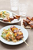 Peach and pork skewers with couscous salad