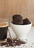 Brigadeiros (Brazilian chocolate pralines) with an espresso