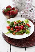 Mixed leaf salad with strawberries and balsamic vinegar