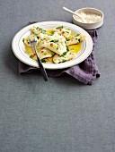 Potato dough ravioli with rocket pesto