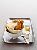 Deep-fried apple cakes with vanilla ice cream and Calvados