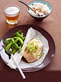 Fish parcel with ginger, spring onions, mange tout and sesame rice
