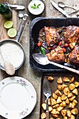 Tandoori chicken legs with basmati rice, potatoes and raita