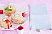 Croissant-Doughnuts with ice cream and strawberry sauce