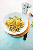 Chicken breast fillet with a curry crust and oriental noodles