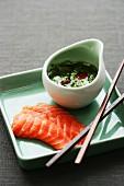 Salmon sashimi with coriander and lime sauce