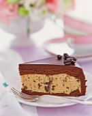 A slice of chocolate cake with mocha beans