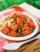 A summery watermelon salad with spring onions