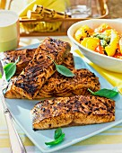 Salmon fillets with basil and vegetables