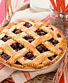 Cherry pie on a wicker tray