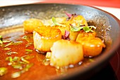 Caramelised scallops with field thyme, red shiso cress and sorrel in a pan