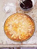 Pear and almond tart with a chocolate and cherry sauce