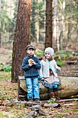 Hansel and Gretel eating bread in woods