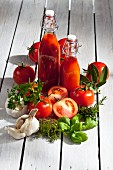 An arrangement of tomatoes featuring tomato juice, tomatoes and fresh herbs