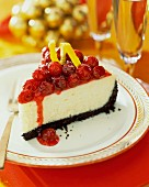 A slice of cheesecake with cranberry sauce