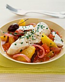 Fish fillet with oranges, tomatoes and olives