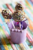 Cake pops in a small purple bucket