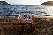A table laid on a beach (Turkey)