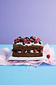 Chocolate-rum cake with cream and fresh berries