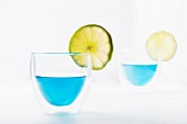 Two glasses of Blue Curacao garnished with lime