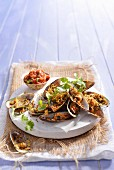 Mussels gratinated with breadcrumbs served with tomato salsa
