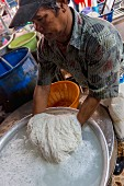 Kanom Jeen (fermented rice noodles, Thailand) being made