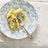 Warm potato salad with gherkins and spring onions