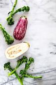 An aubergine and broccoli