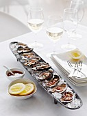 Oysters with vinaigrette and lemon slices