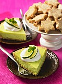 Lime cheesecake with cream and star-shaped biscuits