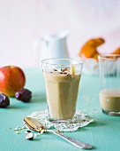 A breakfast smoothie made with dates, pears, apples, nuts and milk