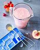 A Melba smoothie made with peaches, berries and vanilla ice cream