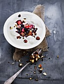 Yoghurt cream with a berry and apple compote and nuts