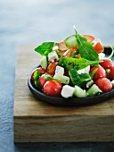 A colourful vegetable salad with feta cheese