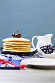 A stack of pancakes with fresh blueberries