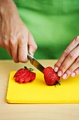 Strawberries being sliced