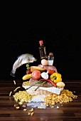 A stack of groceries in a breadbasket on a table