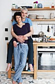 Couple embracing in kitchen