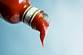 Ketchup dripping out of a bottle