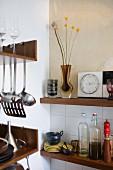 Crockery and utensils on kitchen shelves
