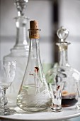 Various decanters of schnapps or liqueur and glasses