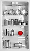 Various tins and a red apple in an open fridge