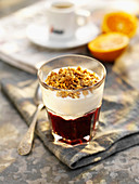 Yogurt muesli, espresso and oranges