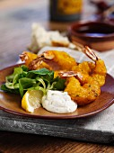 Battered king prawns with mayonnaise and lambs lettuce (Spain)