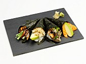 Various types of temaki on a grey platter