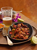 Indian Chicken Sizzler (marinated chicken with onions, peppers and lime, India)
